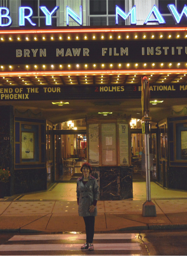 Dr. Harriet Fields standing in front of Bryn Mawr Film Institute's marquee.