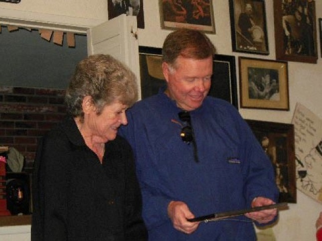 Carolyn Knight and Allen Fields viewing memorabilia.