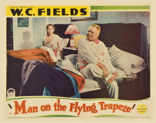 W.C. Fields rolling up his socks before bed in Man on the Flying Trapeze.