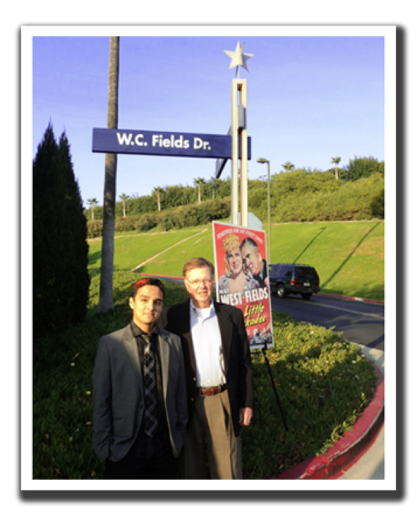 Allen Fields and Austin Fields standing next to W.C. Fields Drive sign post.
