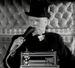 W.C. Fields speaking in a dictaphone mic.