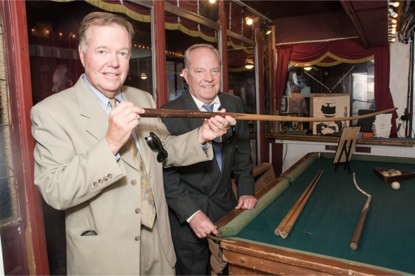 Allen and Ron standig next to pool table.